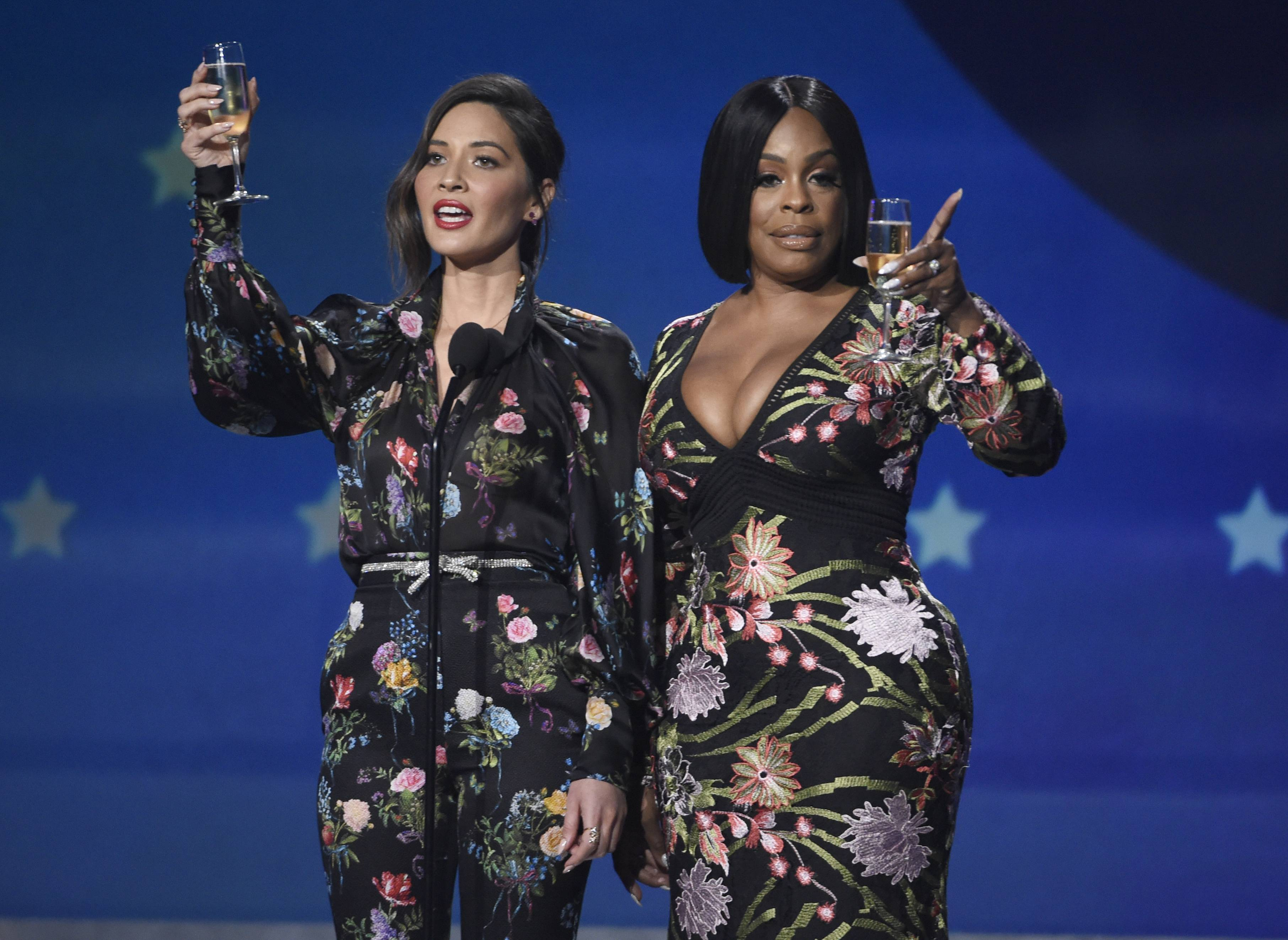 Host Olivia Munn, left, and Niecy Nash speak out at the 23rd annual Critics' Choice Awards Thursday, Jan. 11, in Santa Monica, Calif.