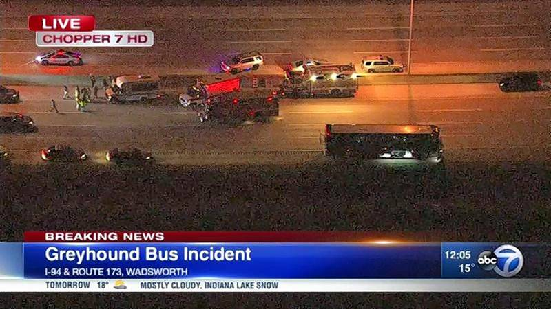 Police were surrounding a Greyhound bus late Friday after an incident involving a gunman on I-94 near the Illinois-Wisconsin state line.