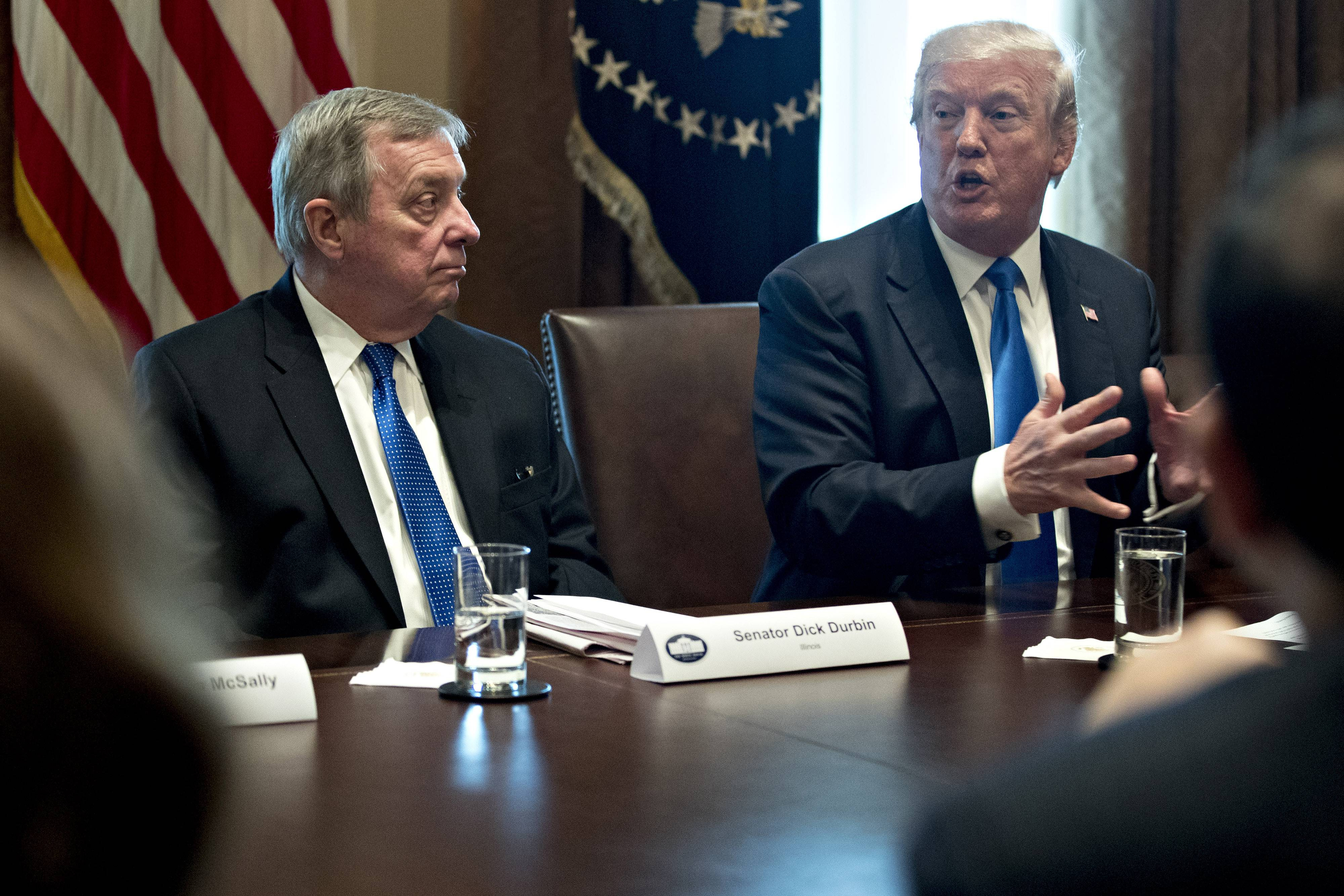 President Donald Trump speaks while Sen. Dick Durbin, D-Ill. (left) listens during a meeting with bipartisan members of Congress on immigration in the Cabinet Room of the White House in Washington, on Jan. 9, 2018.