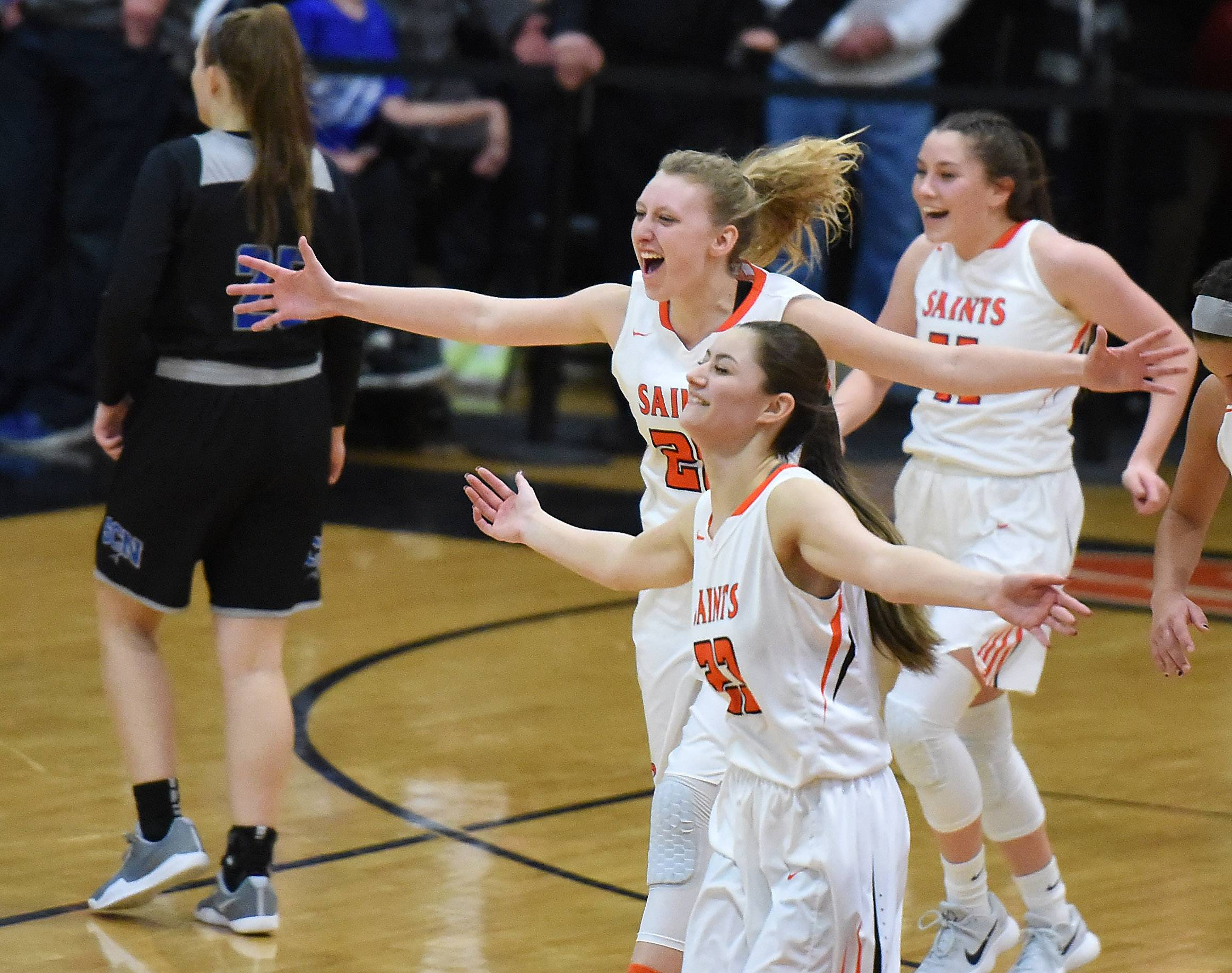 St. Charles East players, including Alexis Kiefer, top middle (20) and Katherine Weinzirl, bottom (23), celebrate after their win over rival St. Charles North during Friday's game at East.