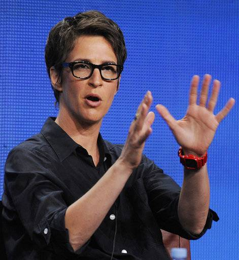"File-This Aug. 2, 2011, file photo shows Rachel Maddow, host of ""The Rachel Maddow Show"" on MSNBC, taking part in a panel discussion at the NBC Universal summer press tour, in Beverly Hills, Calif. Donald Trump ignored it when a reporter asked him at the White House on Friday whether he was a racist. But there's no getting around that more people in the media are willing to use that label. The president's reference to African ""shithole"" countries and reported resistance to more immigration from Haiti felt like a tipping point in the number of people willing to call HIM a racist, rather than say his words or actions exhibited racism. The label came from different places, Comedy Central's Trevor Noah, MSNBC's Maddow, CNN's Don Lemon and Sunny Hostin of ""The View."" (AP Photo/Chris Pizzello, File)"