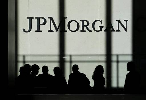 FILE - In this Monday, Oct. 21, 2013, file photo, the JPMorgan Chase & Co. logo is displayed at their headquarters in New York. JPMorgan Chase & Co. reports earnings, Friday, Jan. 12, 2018. (AP Photo/Seth Wenig, File)