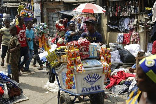 "Pedestrians shop in a roadside market in Lagos, Nigeria, Friday, Jan. 12, 2018. Africans were shocked on Friday to find President Donald Trump had finally taken an interest in their continent. But it wasn't what people had hoped for. Using vulgar language, Trump on Thursday questioned why the U.S. would accept more immigrants from Haiti and ""shithole countries"" in Africa rather than places like Norway in rejecting a bipartisan immigration deal. On Friday he denied using that language. (AP Photo/Sunday Alamba)"