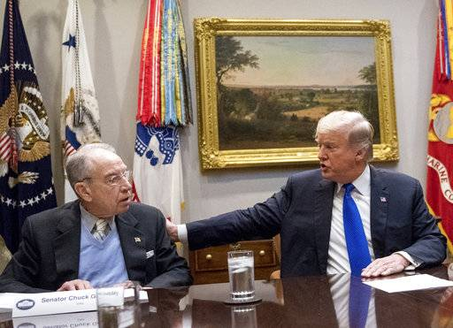 FILE - In this Jan. 4, 2018, President Donald Trump, accompanied by Sen. Chuck Grassley, R-Iowa, left, speaks at a meeting in the Roosevelt Room at the White House in Washington. Republicans who spent the early months of 2017 working with Democrats on investigations into Russian interference in U.S. elections have pivoted as the new year begins, leaving the conclusions of those congressional probes in doubt. (AP Photo/Andrew Harnik)