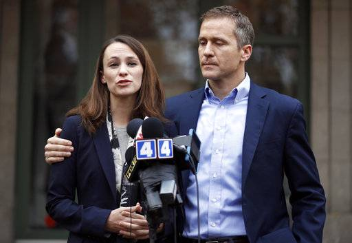 FILE - In this Dec. 6, 2016, file photo, Missouri Gov.-elect Eric Greitens and his wife Sheena speak to the media in St. Louis after she had been robbed at gunpoint the day before. Missouri Gov. Eric Greitens appears to be bracing for a fight to preserve his political life after admitting to an extramarital affair but denying anything more. Greitens met Thursday, Jan. 11, 2018, with Cabinet members and placed calls to rally support while his attorney issued firm denials to a smattering of allegations related to the 2015 affair. (AP Photo/Jeff Roberson, File)