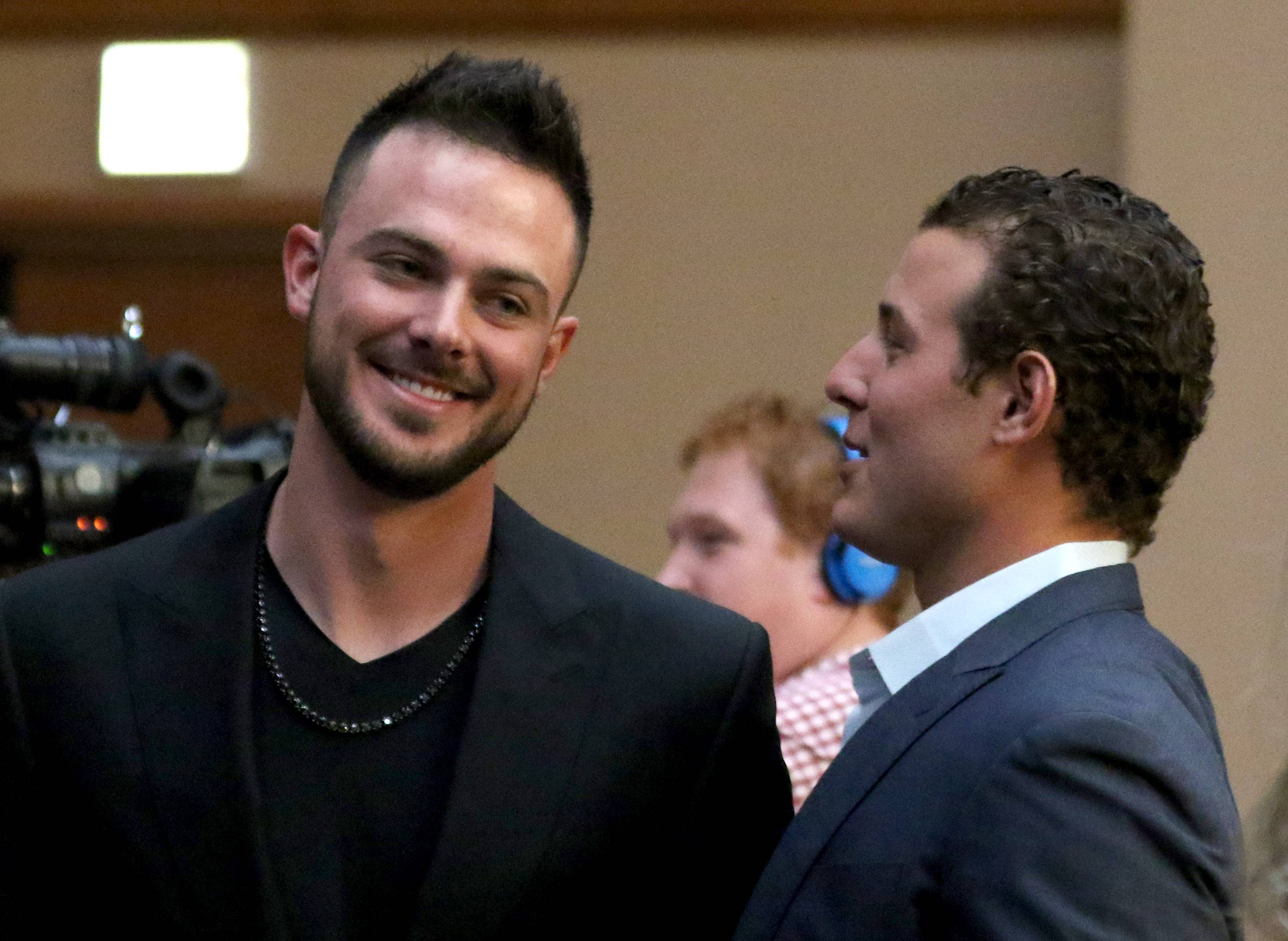 Kris Bryant and Anthony Rizzo greet each other during opening night of the 33rd annual Cubs Convention in Chicago Friday night.