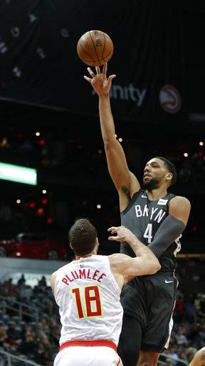 Brooklyn Nets center Jahlil Okafor (4) shoots over Atlanta Hawks center Miles Plumlee (18) in the first half of an NBA basketball game Friday, Jan. 12, 2018, in Atlanta. (AP Photo/John Bazemore)