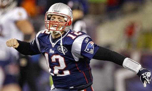 FILE - In this Jan. 22, 2012, file photo, New England Patriots quarterback Tom Brady (12) celebrates after scoring a one yard touchdown during the second half of the AFC Championship NFL football game against the Baltimore Ravens, in Foxborough, Mass. Two things have been consistent for Patriots over the past decade: Tom Brady and reaching the AFC championship game. The Patriots' 40-year-old quarterback will try to lead his team to a place in its seventh straight conference title game when it hosts the Titans.