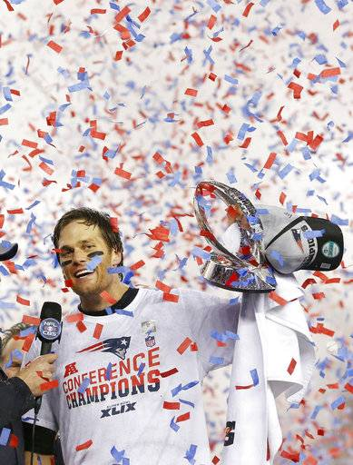FILE - In this Jan. 18, 2015, file photo, New England Patriots quarterback Tom Brady holds up the championship trophy after the NFL football AFC Championship game against the Indianapolis Colts, in Foxborough, Mass. Two things have been consistent for Patriots over the past decade: Tom Brady and reaching the AFC championship game. The Patriots' 40-year-old quarterback will try to lead his team to a place in its seventh straight conference title game when it hosts the Titans.