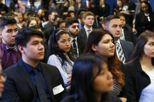 "Students of Year Up Chicago, a one-year long job training program that provides low-income young adults, listens to Sen. Dick Durbin, an Illinois Democrat, Friday, Jan. 12, 2018, in Chicago. The senator present at a White House immigration meeting says President Donald Trump used vulgar language to describe African countries, saying he ""said these hate filled things and he said them repeatedly."""