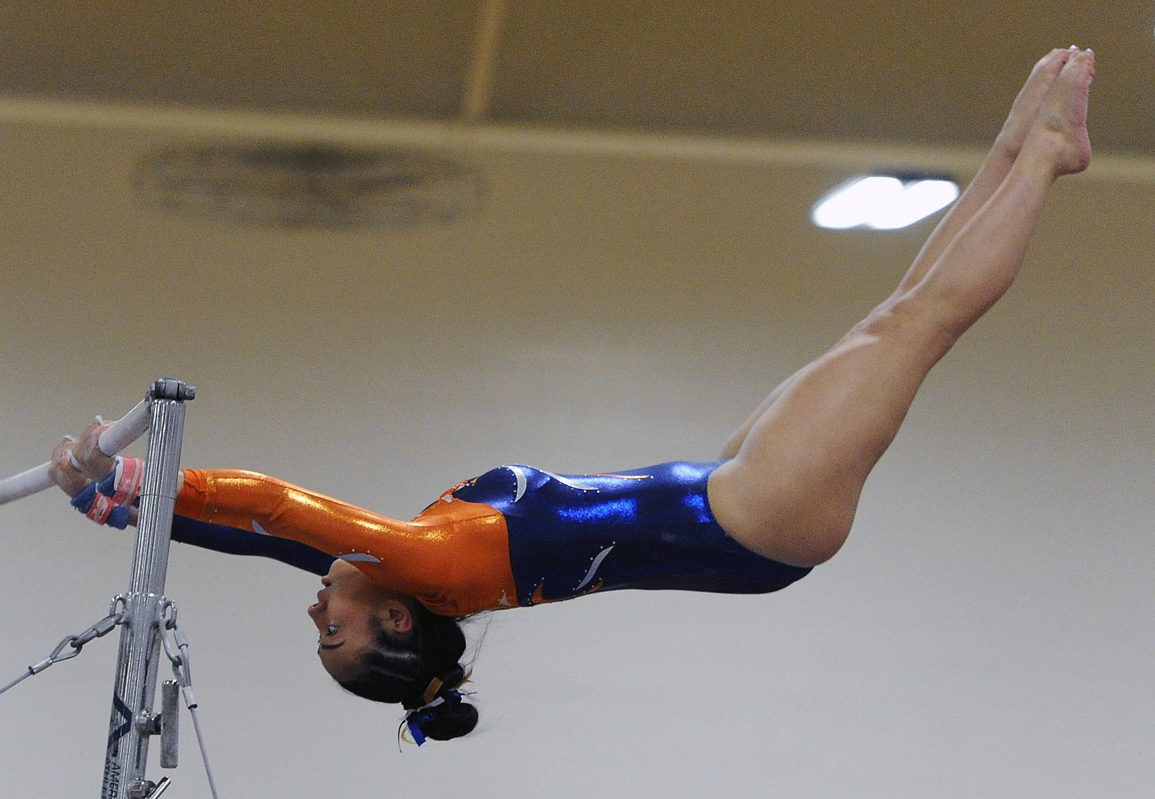 Buffalo Grove's Madison Morelli works the uneven parallel bars at Prospect's invitiatonal on Saturday.