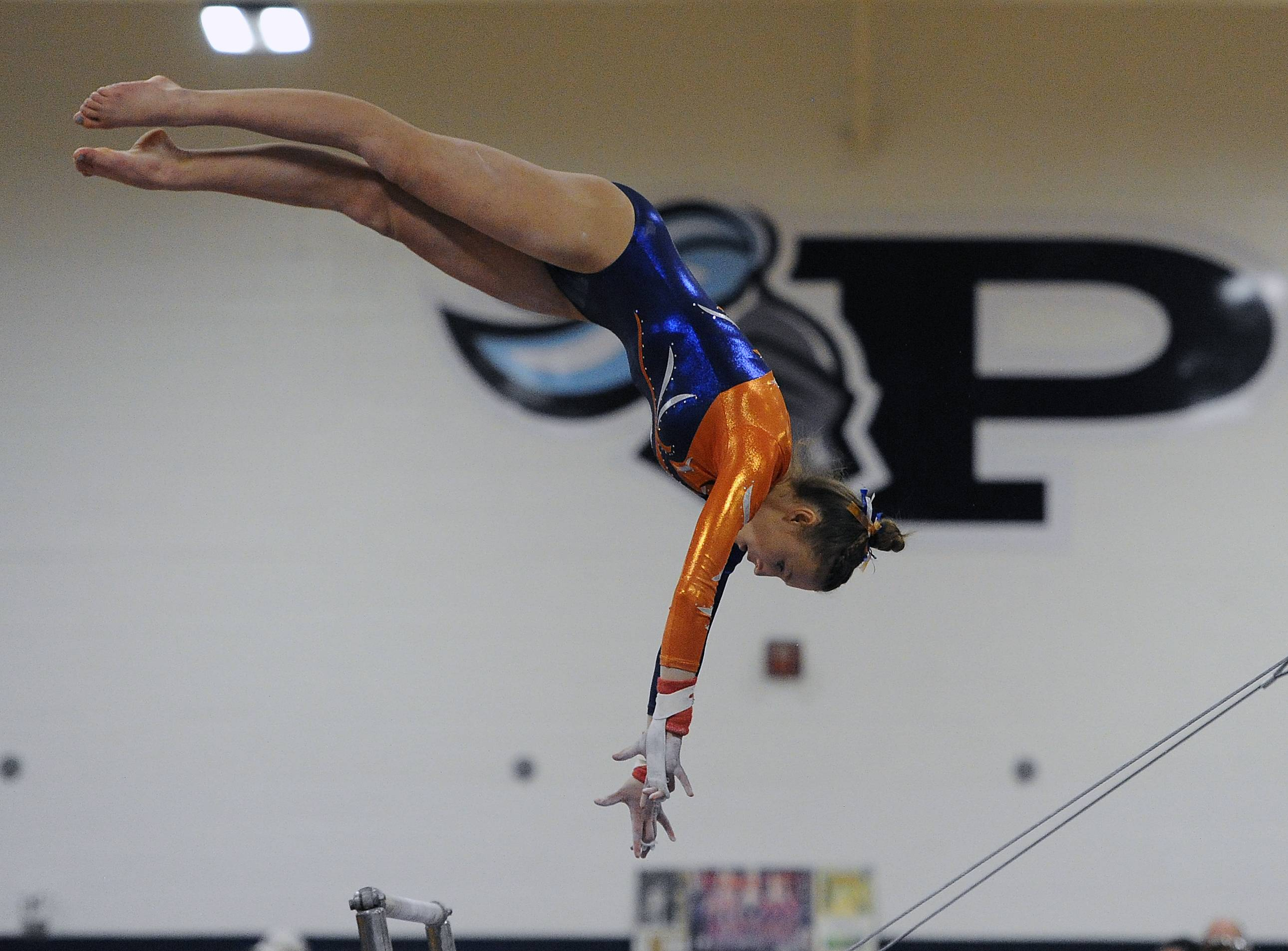 Buffalo Grove's Dagmara Sobolak performs on the uneven parallel bars at Prospect on Saturday.