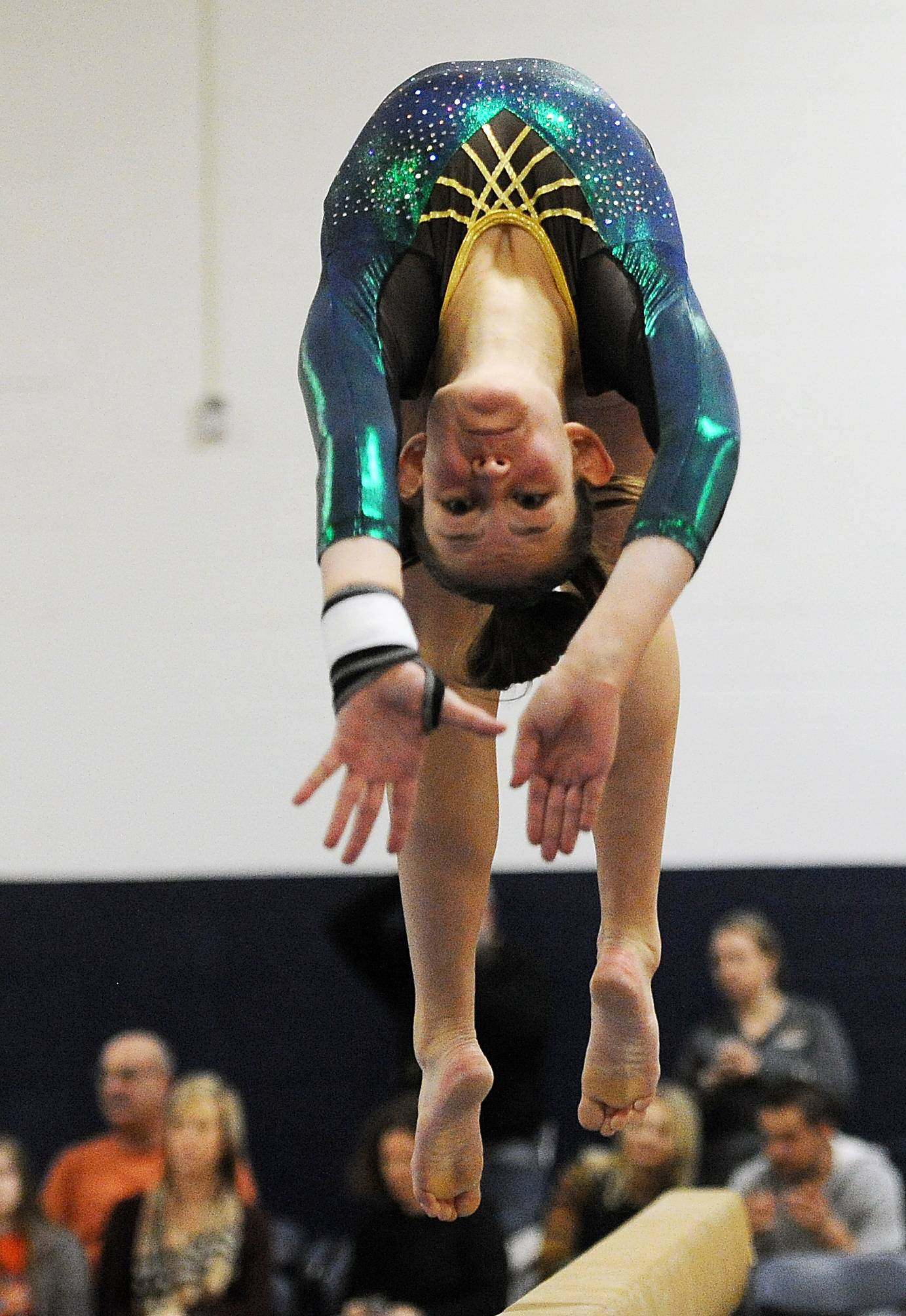Elk Grove's Anna Sprenger performs on balance beam at Prospect on Saturday.