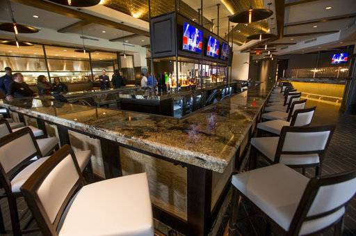 This photo taken Tuesday, Jan. 9, 2018, shows The bar area of the Kankakee Grille inside the new Four Winds Casino Resort in South Bend, Ind. The Pokagon Band of Potawatomi Indians is set to open the casino on Tuesday, Jan. 16, joining three other casinos it already operates nearby in southwestern Michigan.  (Robert Franklin/South Bend Tribune via AP)