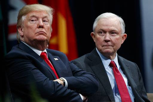 FILE - In this Dec. 15, 2017, file photo, President Donald Trump sits with Attorney General Jeff Sessions during the FBI National Academy graduation ceremony in Quantico, Va. Late last year, lawyers for Trump expressed optimism that special counsel Robert Mueller was nearing the end of his probe of Russia's interference in the 2016 election. But if there was hope in the White House that Trump might be moving past an investigation that has dogged his presidency from the start, 2018 is beginning without signs of abatement.