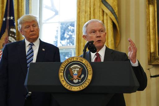 FILE - In this Feb. 9, 2017, file photo, President Donald Trump listens as Attorney General Jeff Sessions speaks in the Oval Office of the White House in Washington, after Vice President Mike Pence administered the oath of office to Sessions. Late last year, lawyers for Trump expressed optimism that special counsel Robert Mueller was nearing the end of his probe of Russia's interference in the 2016 election. But if there was hope in the White House that Trump might be moving past an investigation that has dogged his presidency from the start, 2018 is beginning without signs of abatement.