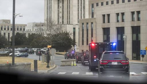 President Donald Trump's motorcade, seen from the media van, arrives at Walter Reed National Military Medical Center in Bethesda, Md, Friday, Jan. 12, 2018, where he will have his first medical check-up as president.