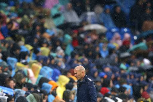 Real Madrid's head coach Zinedine Zidane walks back to the bench during a Spanish La Liga soccer match between Real Madrid and Villarreal at the Santiago Bernabeu stadium in Madrid, Spain, Saturday, Jan. 13, 2018.