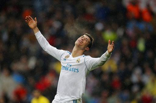 Real Madrid's Cristiano Ronaldo reacts during a Spanish La Liga soccer match between Real Madrid and Villarreal at the Santiago Bernabeu stadium in Madrid, Spain, Saturday, Jan. 13, 2018.