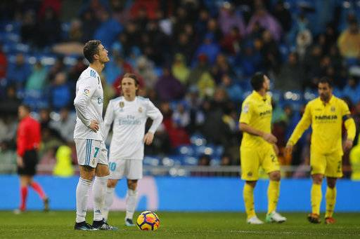 Real Madrid's Cristiano Ronaldo, left, waits to kick off with Luka Modric after Villarreal scored during a Spanish La Liga soccer match between Real Madrid and Villarreal at the Santiago Bernabeu stadium in Madrid, Spain, Saturday, Jan. 13, 2018.