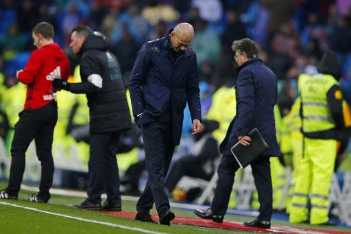 Real Madrid's head coach Zinedine Zidane reacts after Villarreal scored the winning goal during a Spanish La Liga soccer match between Real Madrid and Villarreal at the Santiago Bernabeu stadium in Madrid, Spain, Saturday, Jan. 13, 2018.