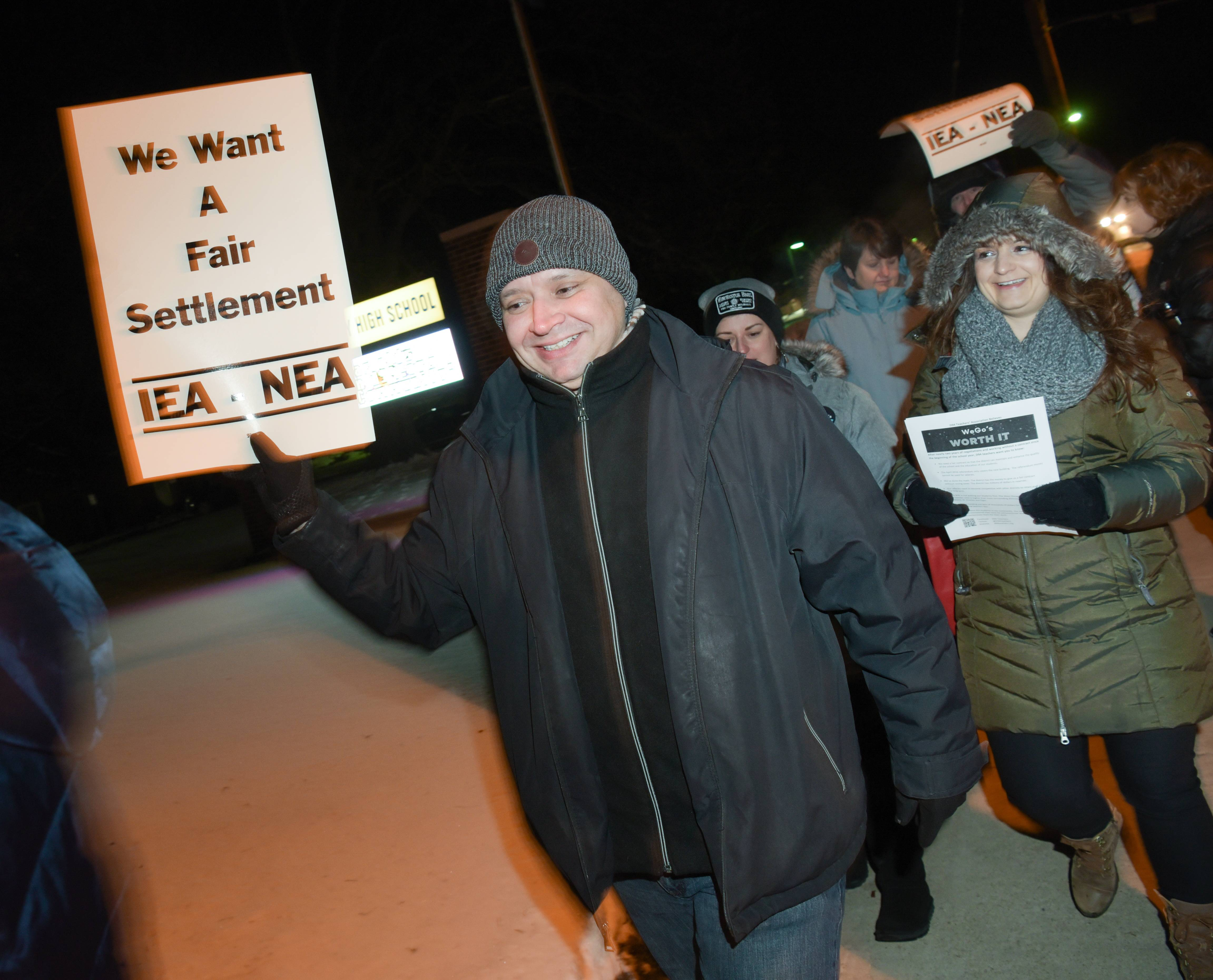 West Chicago High School social worker Bill Bautista marches outside West Chicago High School during an informational picket before Tuesday's school board meeting.