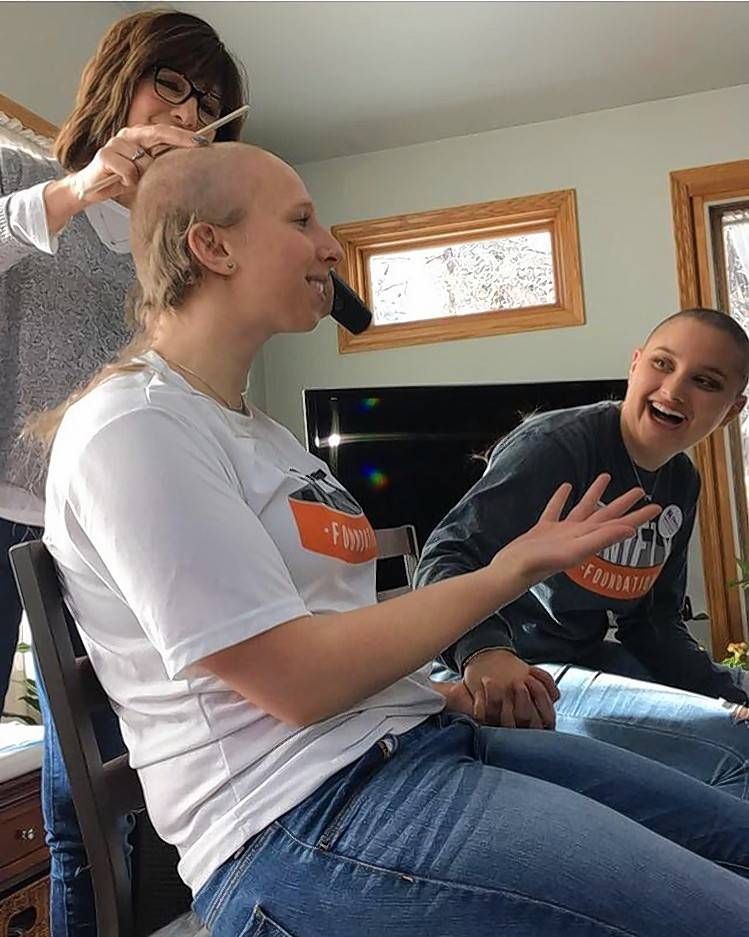 Naperville North grads shave their heads for cancer charity