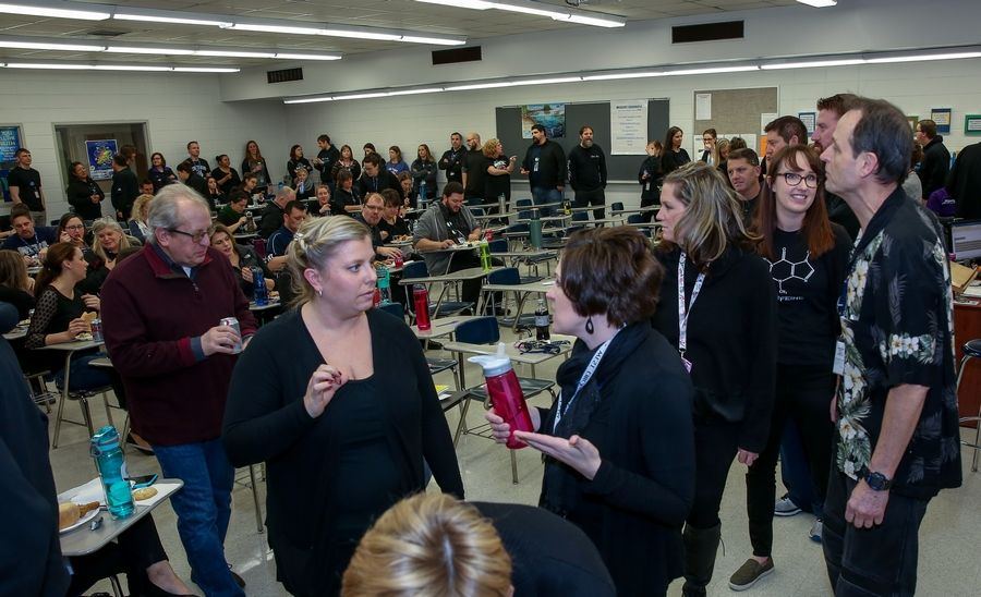 Teachers gather Friday at West Chicago High School shortly before voting to authorize a strike.
