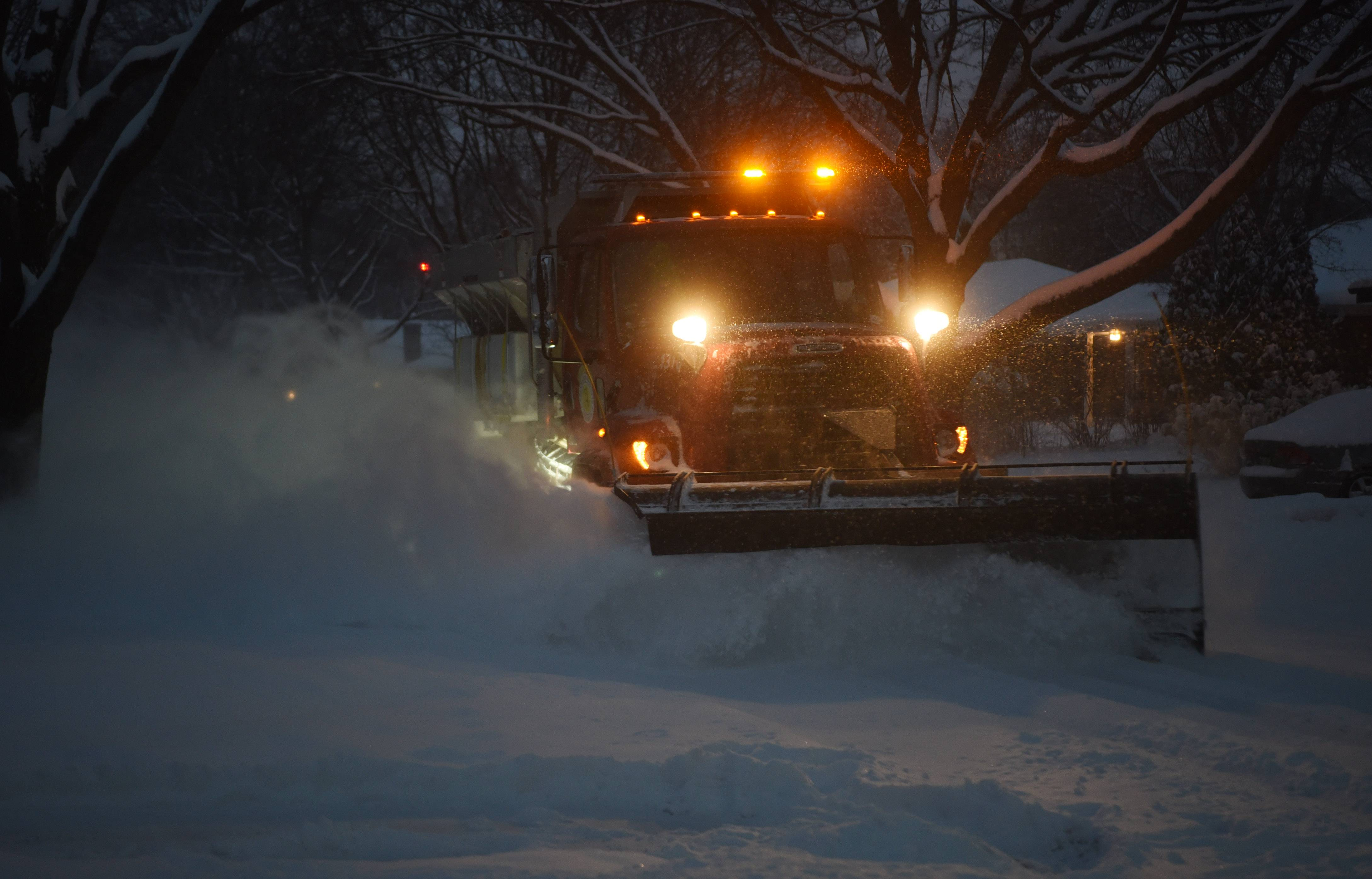 A plow clears South Walnut Avenue in Arlington Heights during Friday snowstorm.