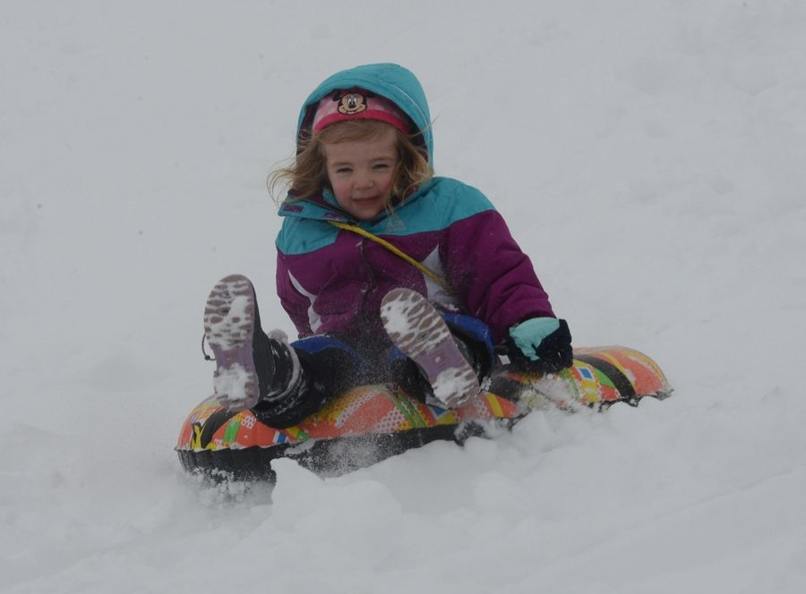 Zoe Milakowitsch, 5, of Mundelein descends the sled hill at Community Park in Mundelein during Friday's snowstorm.