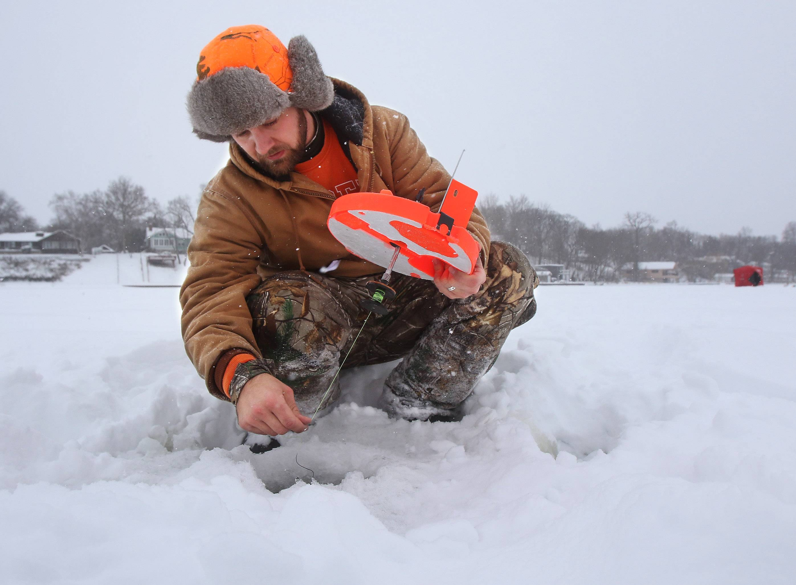 Snow, chill can't keep anglers away from Antioch fishing derby