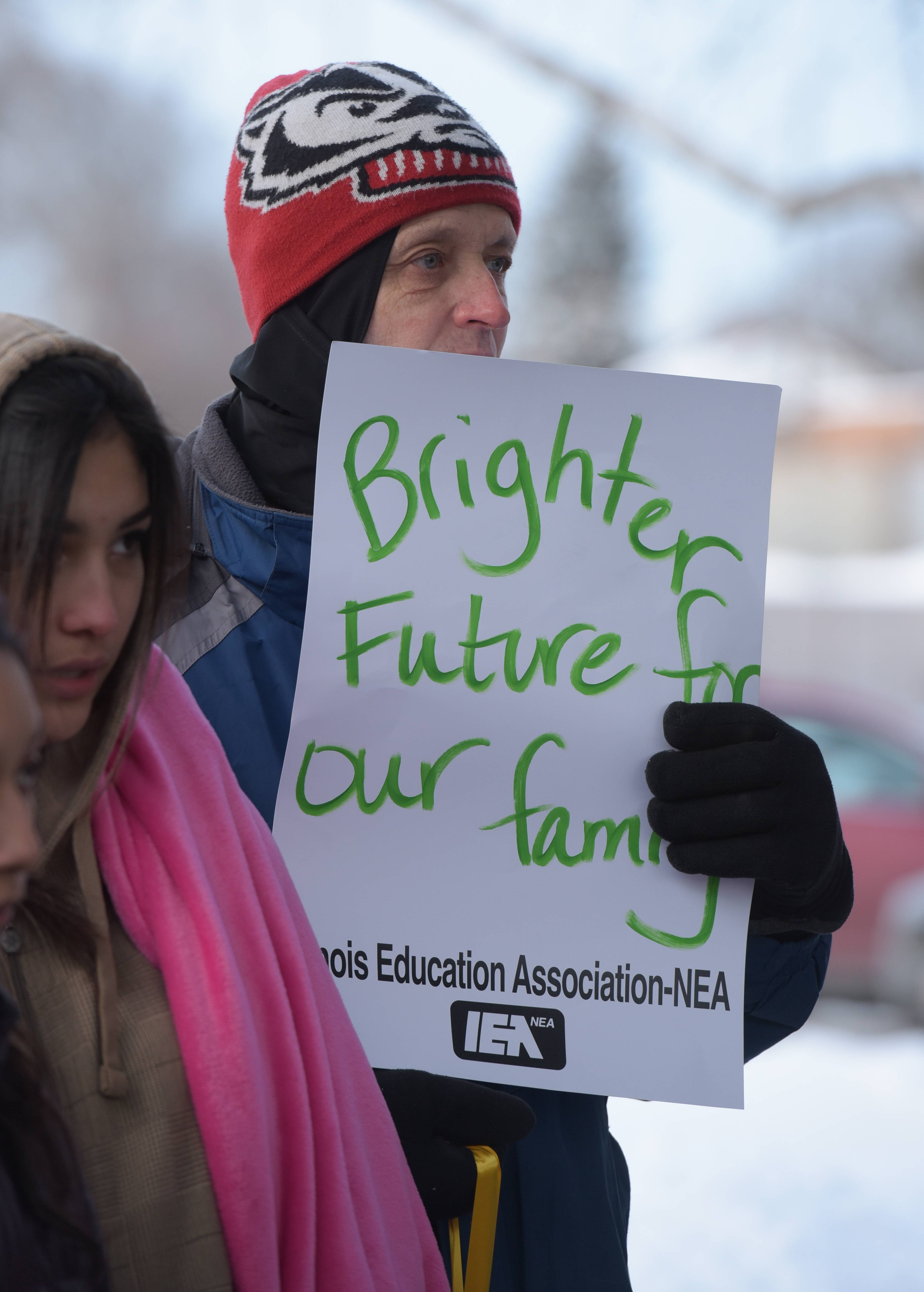 David Exner, an art teacher at West Chicago High School, attends the candlelight vigil outside district offices Monday.
