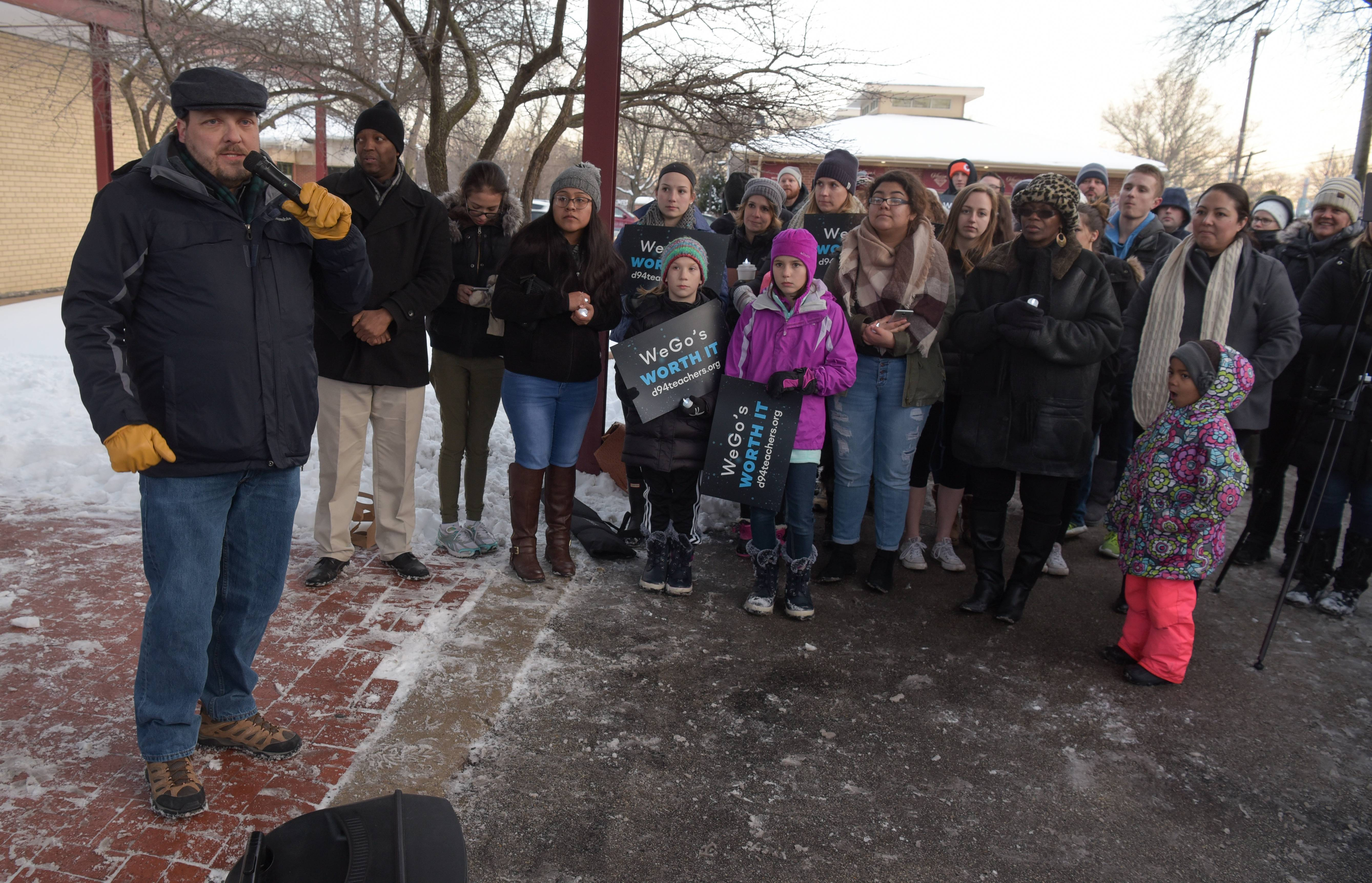"West Chicago High School teachers union President Brad Larson speaks during a candlelight vigil ""to pray for a fair"" contract settlement outside district office on Monday."