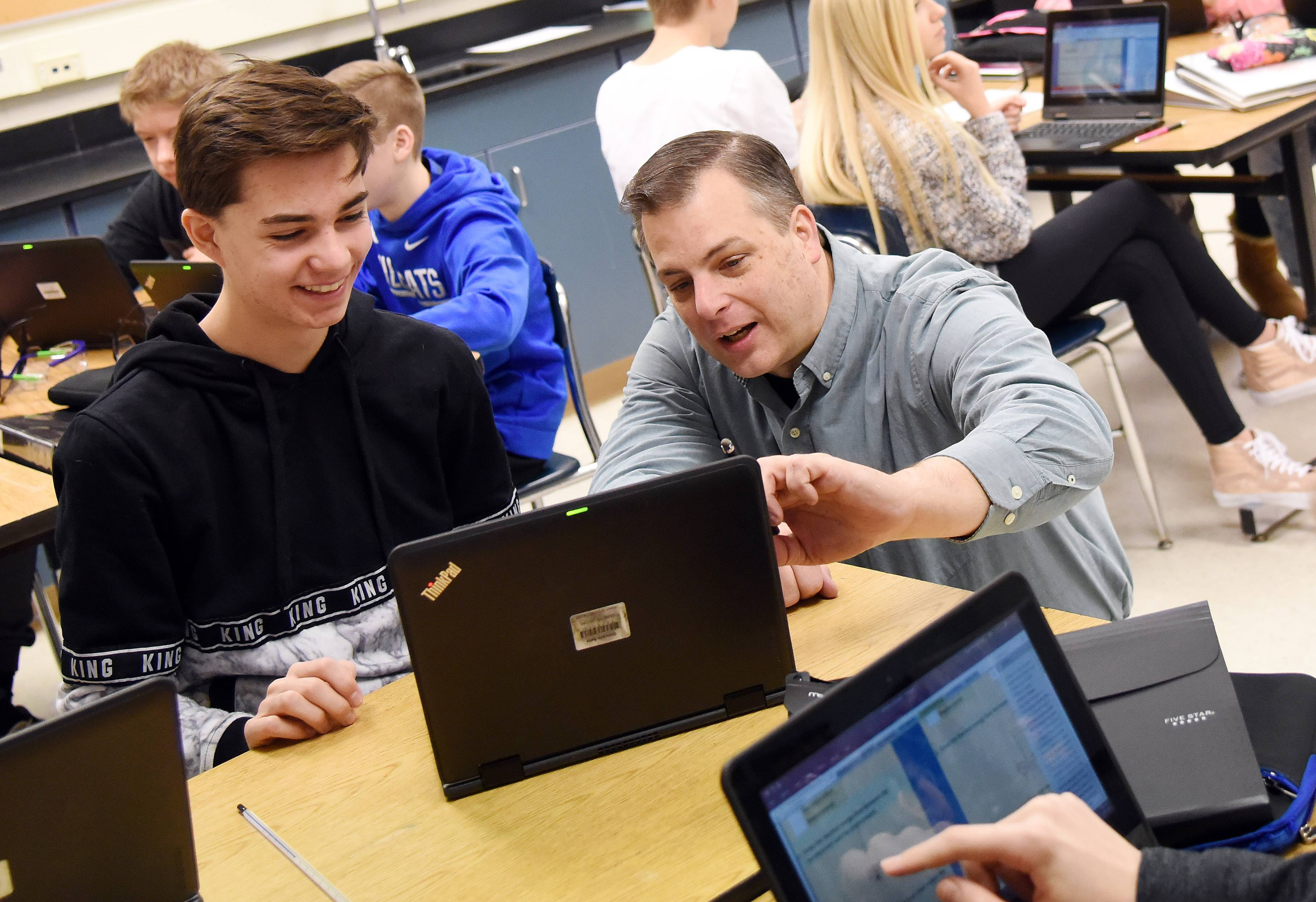 Science teacher Matt Gain works with eighth-grader Giancarlo Rella during class. Gain has taught chemistry and physics at Geneva Middle School South for 17 years and was named the Kane County Educator of the Year in 2017.