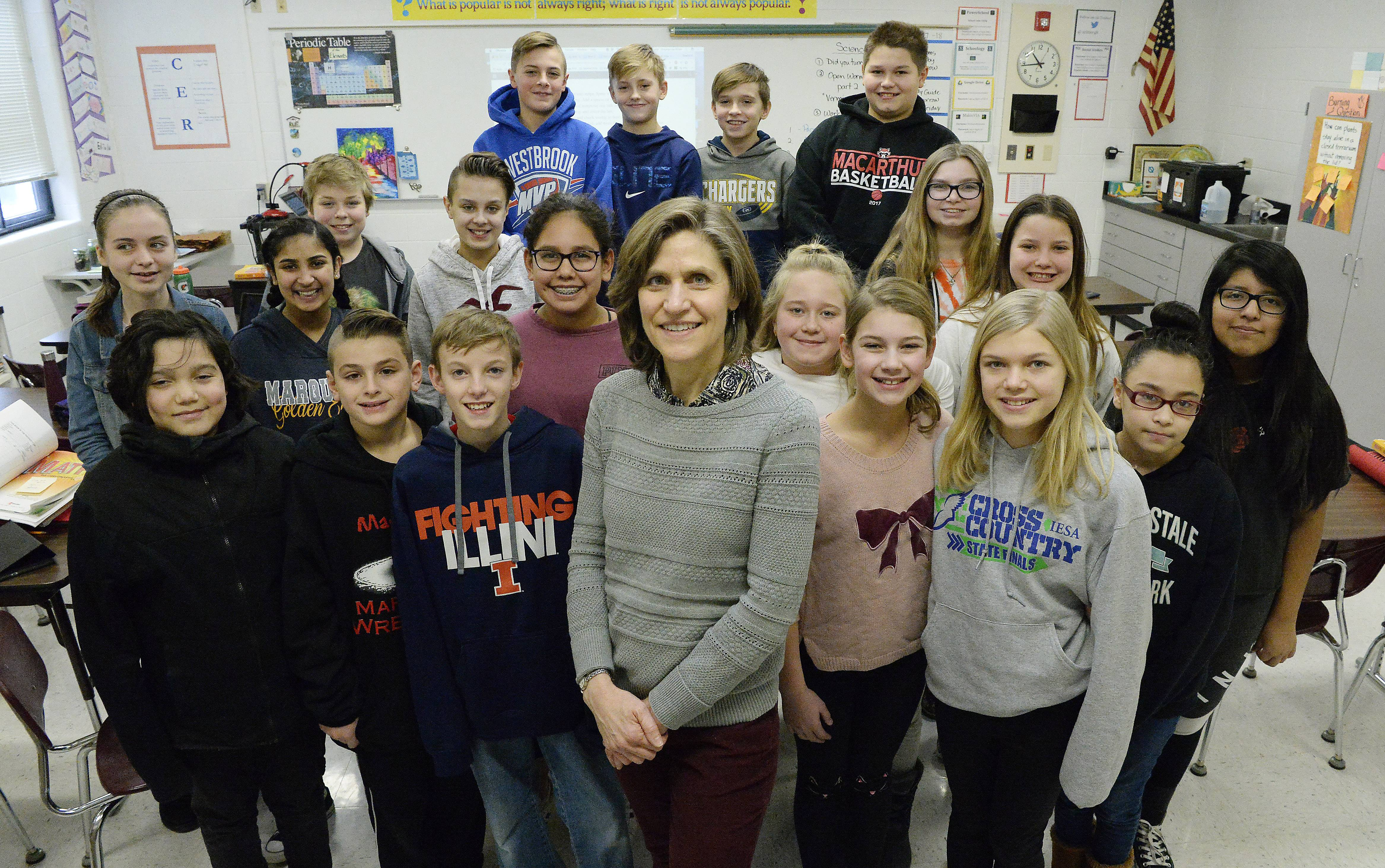 Stephanie Ritter, here with some of her sixth-grade students at MacArthur Middle School in Prospect Heights, worked in advertising for seven years before launching a second career as a teacher.
