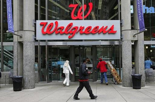 FILE - This June 4, 2014, file photo, shows a Walgreens retail store in Boston. Shares of AmerisourceBergen are soaring before the opening bell, Tuesday, Feb. 13, 2018, on reports that Walgreens is pursuing a complete takeover of the huge drug distributor. The Wall Street Journal is reporting that Walgreens CEO Stefano Pessina reached out to AmerisourceBergen Corp. with the potential deal. Walgreens already owns about 26 percent of the company. (AP Photo/Charles Krupa, File)