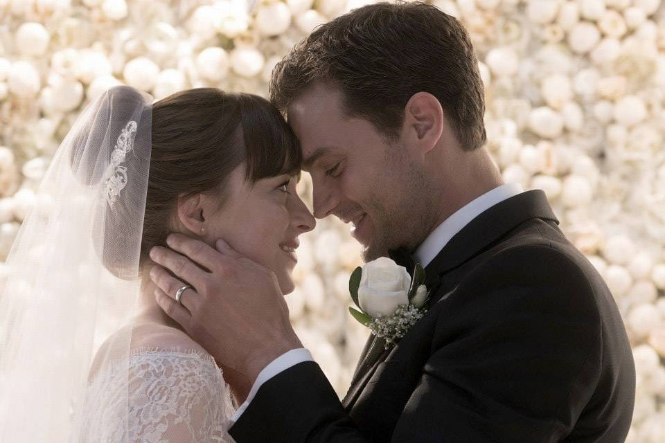 "Dakota Johnson and Jamie Dornan star in ""Fifty Shades Freed."""