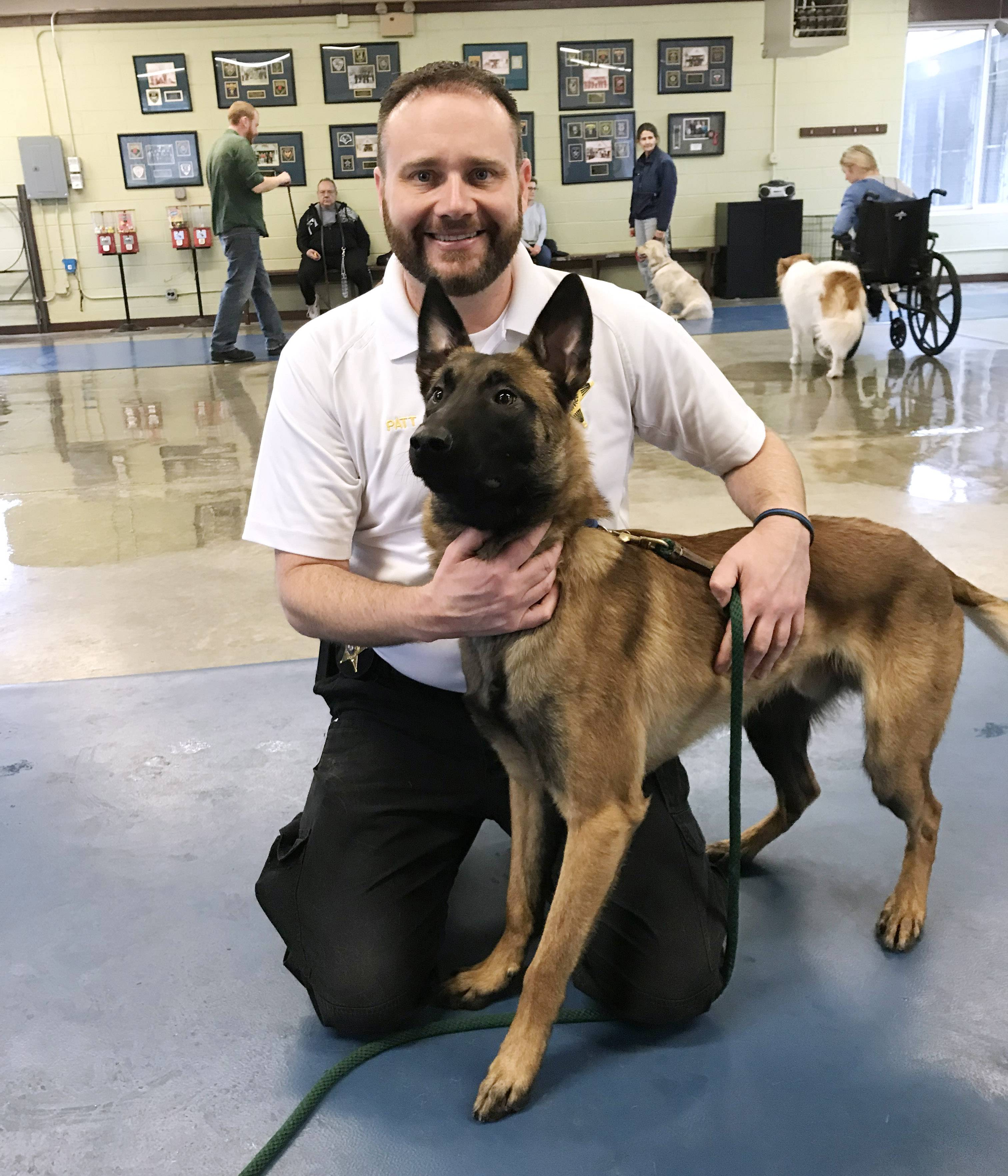 Chief Deputy Coroner Jason Patt with Bones, a one-year-old Belgian Malinois that is being trained as a cadaver dog for the Lake County Coroner's office. Bones also will be a tracking dog and provide grief support to families.