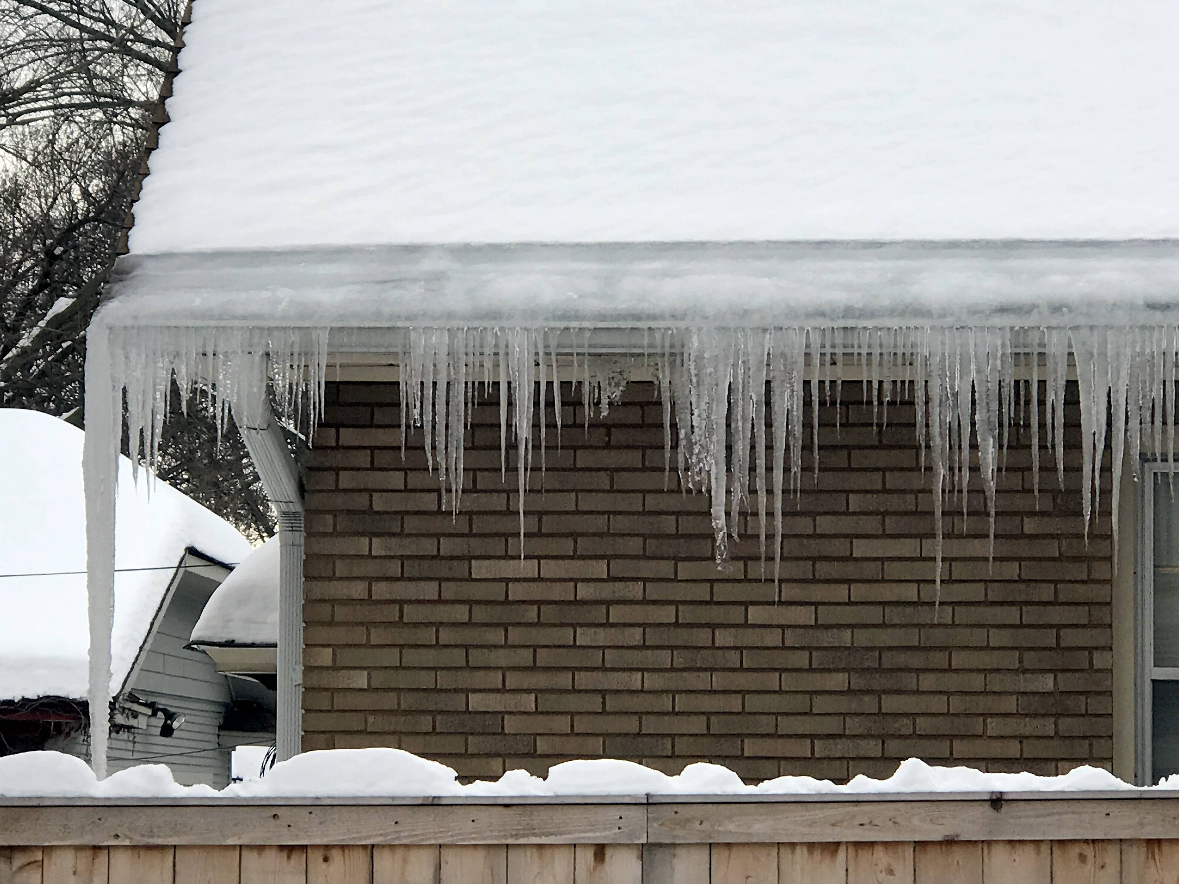 Experts disagree on whether you should remove icicles like these in Elgin, with some saying doing so could damage gutters or siding. But with a thaw and rain coming this week, they might not be the biggest issue your home will have.
