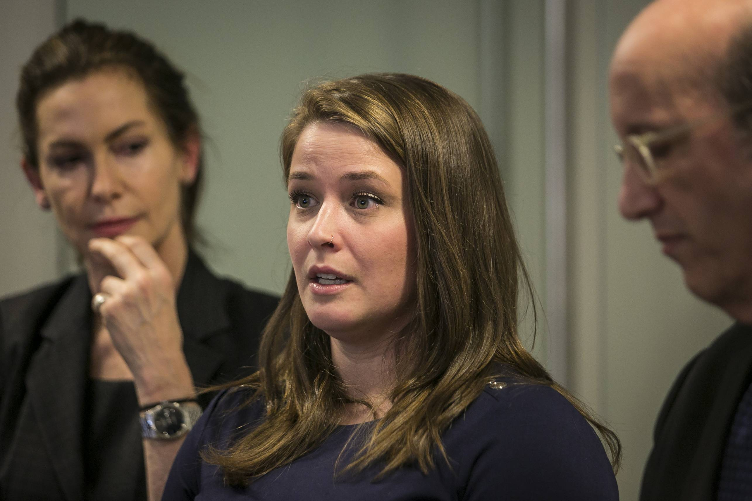 Alaina Hampton, a campaign worker for Illinois Democrats speaks Tuesday during a news conference in Chicago accompanied by advocates Lorna Brett, left and Shelly Kulwin. Hampton addressed reporters a day after House Speaker Michael Madigan dismissed political consultant Kevin Quinn after an investigation found Quinn sent her inappropriate text messages. In November, she wrote Madigan who had an attorney investigate.