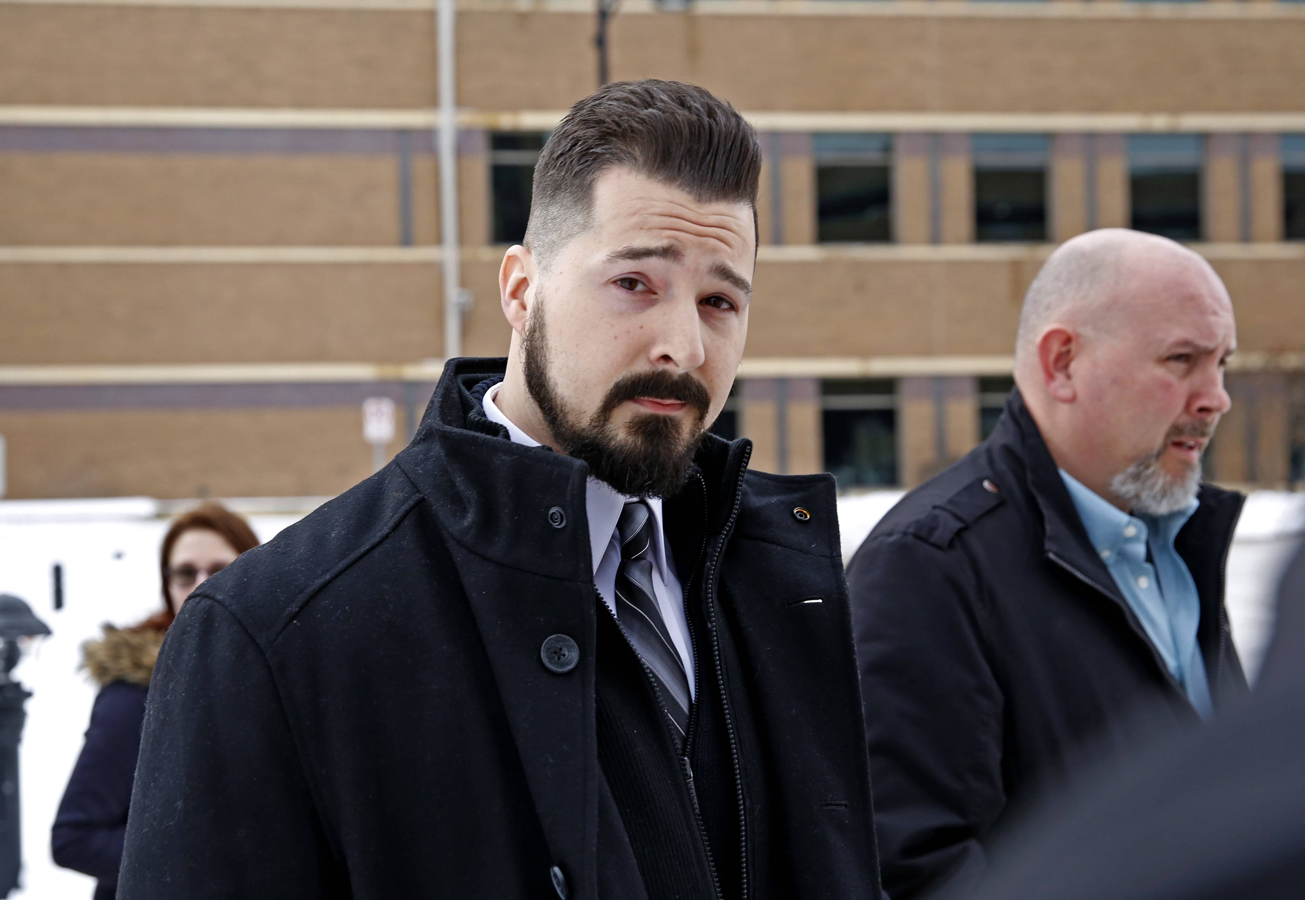 Former Schaumburg police officer John Cichy leaves the DuPage County Courthouse Tuesday after prosecutors dropped all charges against him in connection with a drug-dealing operation with two fellow officers.