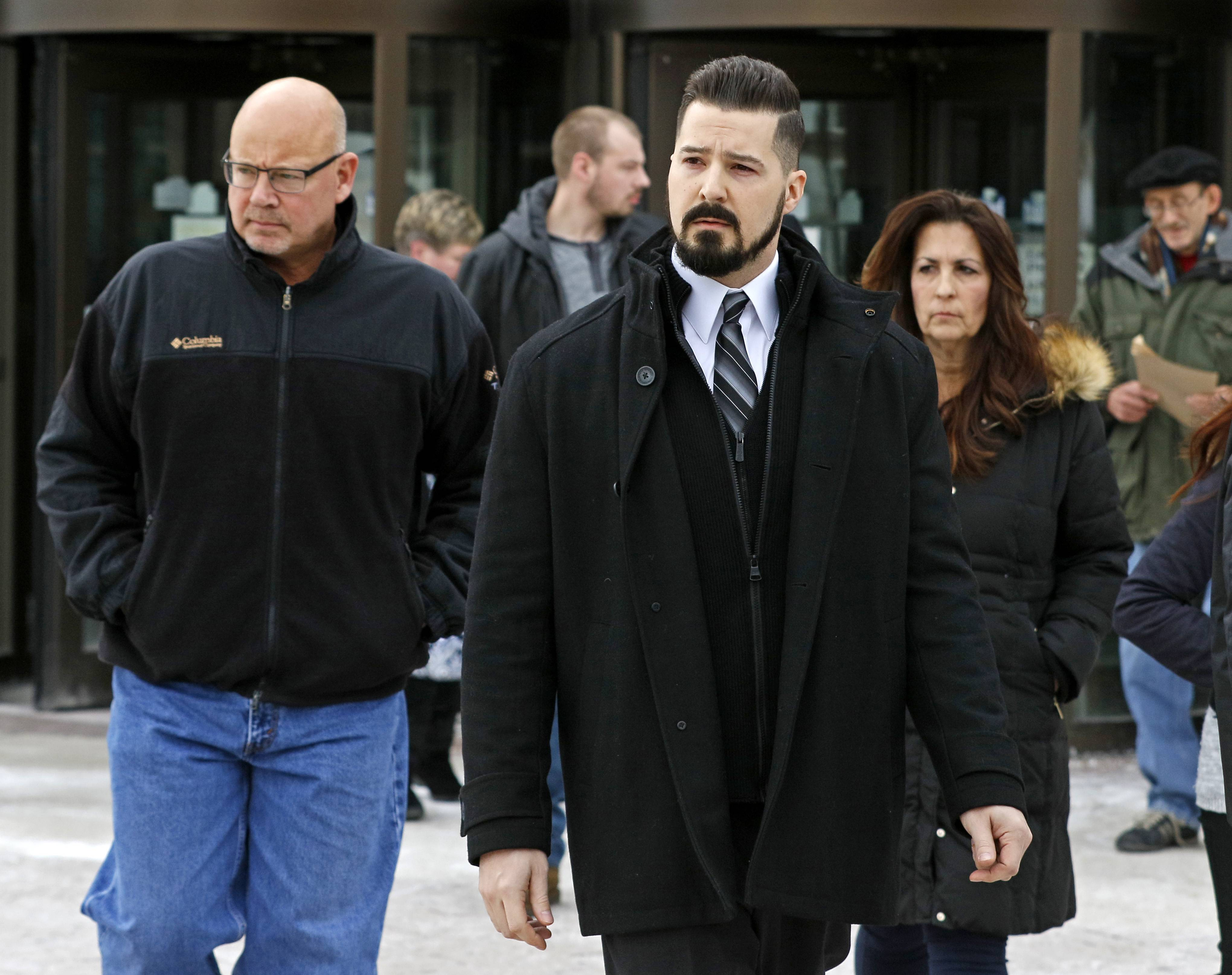 Former Schaumburg police officer John Cichy, center, who has been serving as a youth minister at a church while awaiting trial in connection with a drug-running operation, likely will issue an approved video statement Wednesday after DuPage County prosecutors dropped all charges against him on Tuesday.