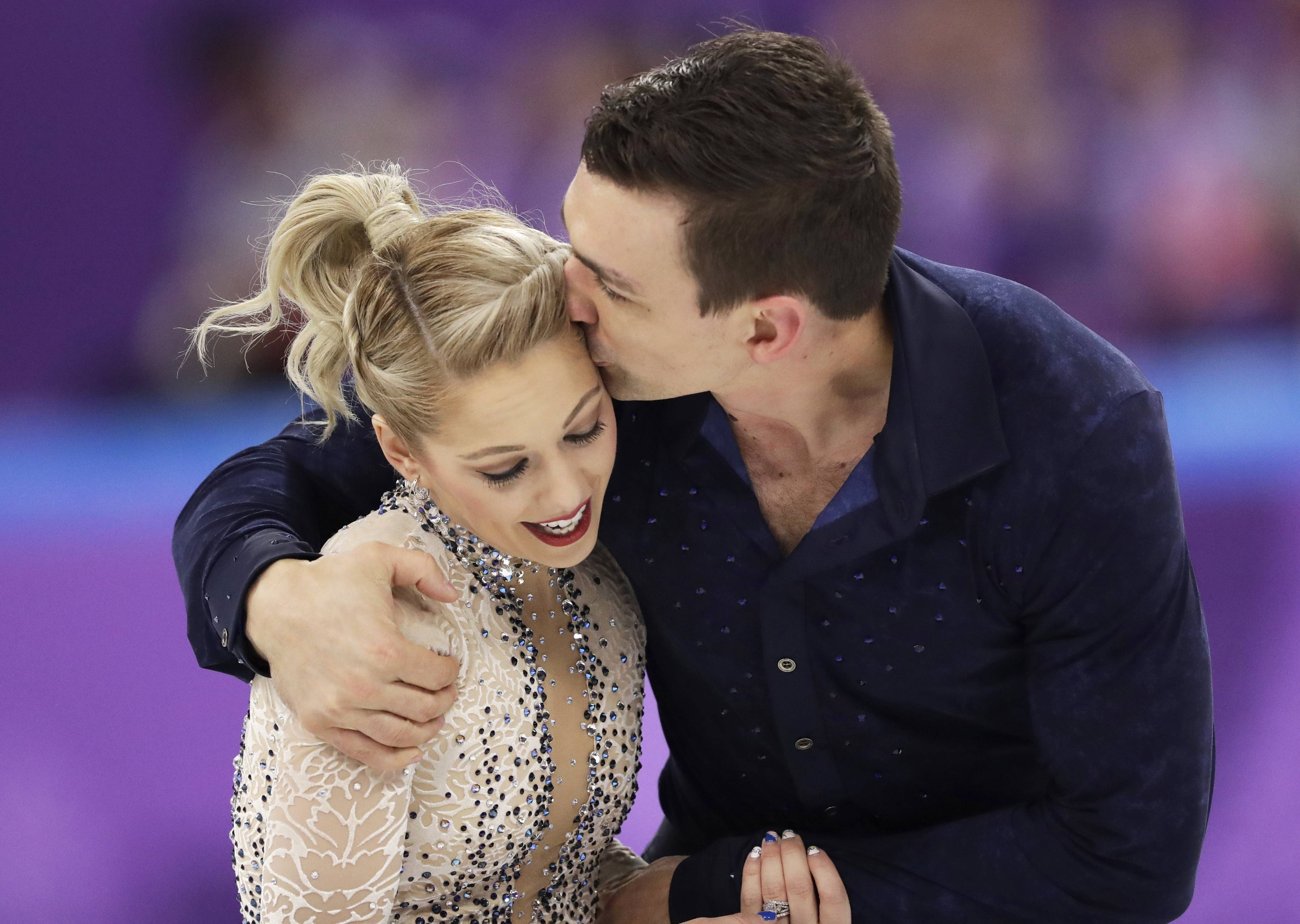 Addison native Alexa Scimeca Knierim and her partner Chris Knierim react after their performance in the pairs figure skating short program in the Gangneung Ice Arena at the 2018 Winter Olympics on Wednesday. The pair scored a 65.55 in the short program, landing them in 14th place. Still the pair says the program is about so much more than their scores.
