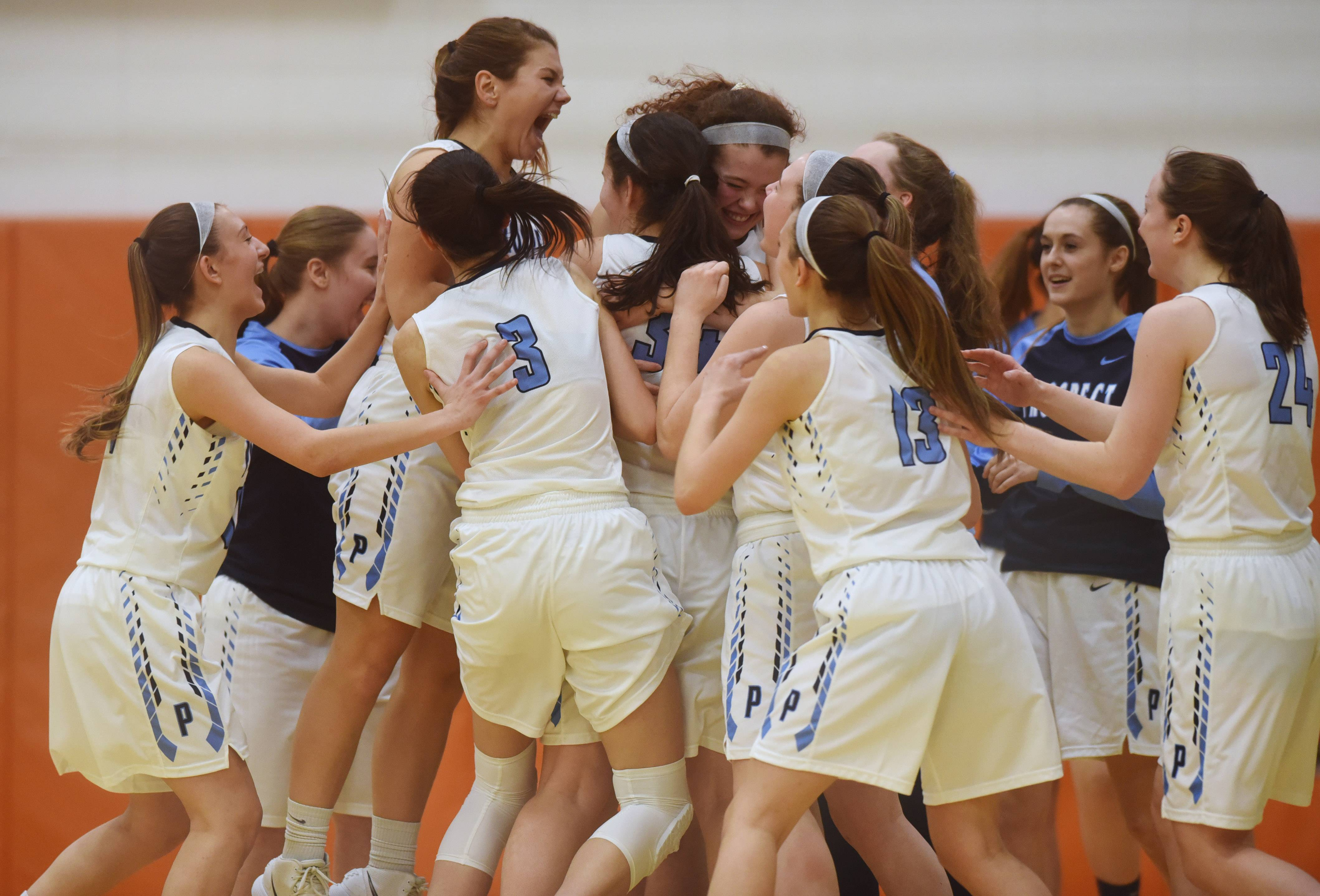 Prospect players celebrate their victory over Hersey during the Class 4A girls basketball regional at Buffalo Grove Tuesday.