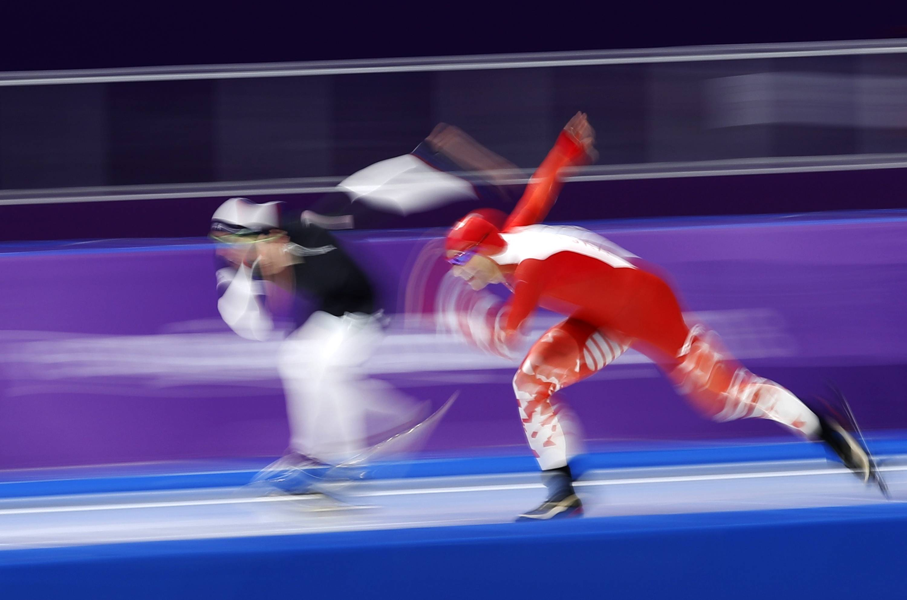 A blur on the ice, Brian Hansen of the United State, left, and Zbigniew Brodka of Poland compete during the men's 1,500 meters speedskating race at the Gangneung Oval at the 2018 Winter Olympics in, Tuesday, Feb. 13, 2018. (AP Photo/Vadim Ghirda)