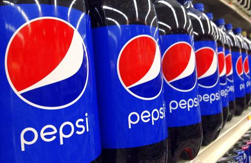 FILE - In this July 9, 2015, file photo, Pepsi bottles are on display at a supermarket in Haverhill, Mass. PepsiCo reports financial results Tuesday, Feb. 13, 2018.