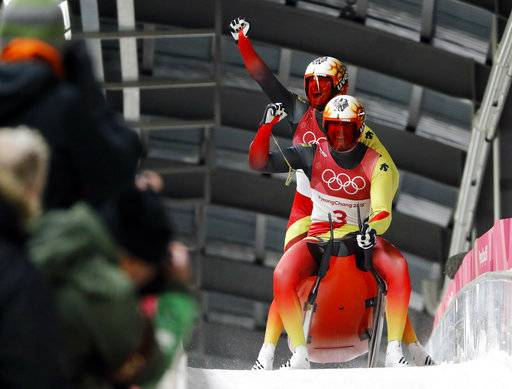 Tobias Arlt and Tobias Wendl of Germany celebrate theor gold medal winning run during the men's doubles luge final at the 2018 Winter Olympics in Pyeongchang, South Korea, Wednesday, Feb. 14, 2018. (AP Photo/Andy Wong)