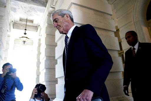 FILE - In this June 21, 2017, file photo, former FBI Director Robert Mueller, the special counsel probing Russian interference in the 2016 election, departs Capitol Hill following a closed door meeting in Washington. While the country waits to see if President Donald Trump will sit for an interview with prosecutors, scores of people sucked into the investigation are waiting for their own signal from special counsel Mueller: whether he's done with them or not.