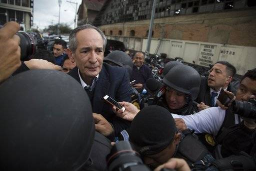 Former Guatemalan President Alvaro Colom, left, is escorted by police to a courtroom in Guatemala City, Tuesday, Feb. 13, 2018. Colom, who governed from 2008 to 2012, has been detained in a corruption case according to special prosecutor Juan Francisco Sandoval.