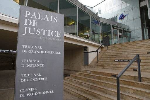 "The entrance of the hall of justice is pictured Tuesday, Feb.13, 2018 in Pontoise, outside Paris. A 29-year-old man is set to appear in a French court Tuesday for having sex with an 11-year-old girl last year, in a trial that has rekindled debate on the age of sexual consent in France. In a decision that shocked many, the prosecutor's office in the Paris suburb of Pontoise decided to send the man to trial on charges of ""sexual abuse of a minor under 15 years old,"" and not rape. (AP Photo/Francois Mori)"